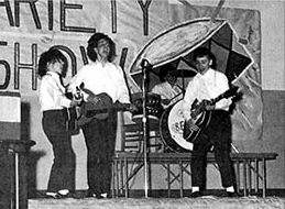 "Pantomiming the ""Beatles"" in February of '64 at Grafton Junior High School. I'm on the left with the ""Regal"" guitar."